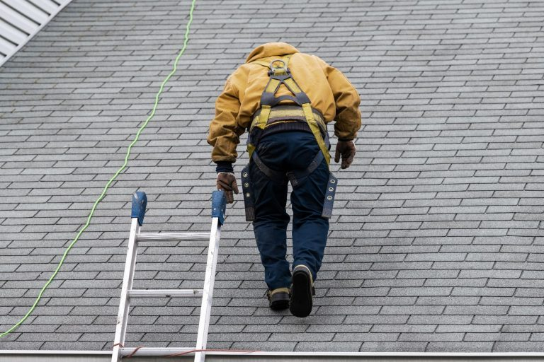 roofer climbing home roof