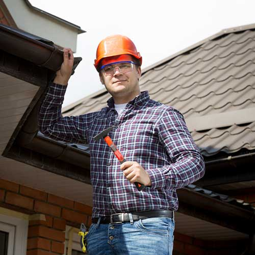 qualified roofing contractor inspecting roof